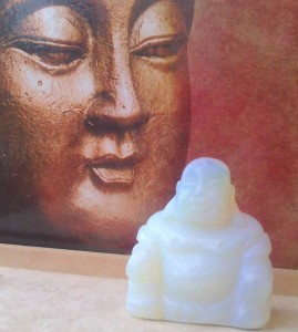 Opalite Carved Buddha - The Laughing Buddha is a very popular cure in Feng Shui. It is believed to bring good luck, wealth and blessings to the home, where it is placed in.